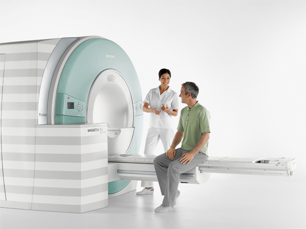 Picture of a man sitting on an MRI table